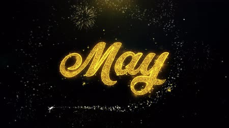 primeiro plano : May Written Gold Glitter Particles Spark Exploding Fireworks Display 4K . Greeting card, Celebration, Party Invitation, calendar, Gift, Events, Message, Holiday, Wishes Festival Vídeos