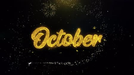 kaligrafia : October Written Gold Glitter Particles Spark Exploding Fireworks Display 4K . Greeting card, Celebration, Party Invitation, calendar, Gift, Events, Message, Holiday, Wishes Festival Wideo
