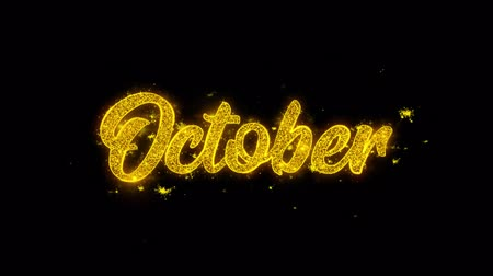 mángorlógép : October Typography Written with Golden Particles Sparks Fireworks Display 4K. Greeting card, Celebration, Party Invitation, calendar, Gift, Events, Message, Holiday, Wishes Festival Stock mozgókép
