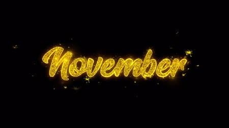 kaligrafia : November Typography Written with Golden Particles Sparks Fireworks Display 4K. Greeting card, Celebration, Party Invitation, calendar, Gift, Events, Message, Holiday, Wishes Festival