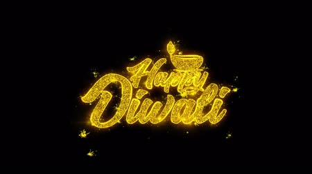 ganesha : Shubh Happy Diwali Typography Written with Golden Particles Sparks Fireworks Display 4K. Greeting card, Celebration, Party Invitation, calendar, Gift, Events, Message, Holiday, Wishes Festival