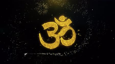 karma yoga : Om or Aum Shiva Written Gold Glitter Particles Spark Exploding Fireworks Display 4K Background Symbol Element Sign