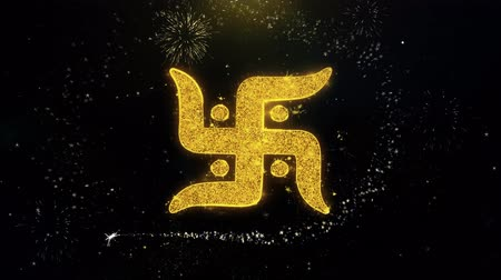 tibet : Swastika Symbol Written Gold Glitter Particles Spark Exploding Fireworks Display 4K . Greeting card, Celebration, Party Invitation, calendar, Gift, Events, Message, Holiday, Wishes Festival