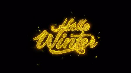 írott : Hello Winter Typography Written with Golden Particles Sparks Fireworks Display 4K. Greeting card, Celebration, Party Invitation, calendar, Gift, Events, Message, Holiday, Wishes Festival