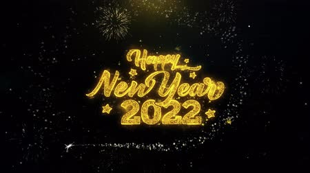 end of year : Happy New Year 2022 Written Gold Glitter Particles Spark Exploding Fireworks Display 4K . Greeting card, Celebration, Party Invitation, calendar, Gift, Events, Message, Holiday, Wishes Festival
