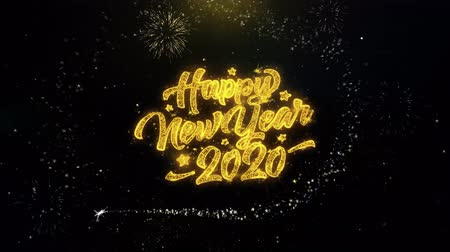 end of year : 2020 Happy New Year Written Gold Glitter Particles Spark Exploding Fireworks Display 4K . Greeting card, Celebration, Party Invitation, calendar, Gift, Events, Message, Holiday, Wishes Festival Stock Footage