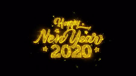 escrita : Happy New Year 2020 Typography Written with Golden Particles Sparks Fireworks Display 4K. Greeting card, Celebration, Party Invitation, calendar, Gift, Events, Message, Holiday, Wishes Festival