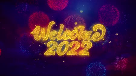 годовой : Welcome 2022 Greeting Text with Particles and Sparks Colored Bokeh Fireworks Display 4K. for Greeting card, Celebration, Party Invitation, calendar, Gift, Events, Message, Holiday, Wishes. Стоковые видеозаписи
