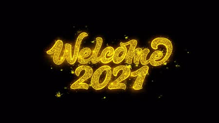 vég : Welcome 2021 Typography Written with Golden Particles Sparks Fireworks Display 4K. Greeting card, Celebration, Party Invitation, calendar, Gift, Events, Message, Holiday, Wishes Festival