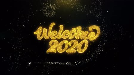 escrita : Welcome 2020 Written Gold Glitter Particles Spark Exploding Fireworks Display 4K . Greeting card, Celebration, Party Invitation, calendar, Gift, Events, Message, Holiday, Wishes Festival