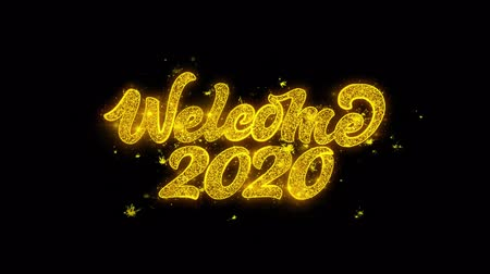 zaproszenie : Welcome 2020 Typography Written with Golden Particles Sparks Fireworks Display 4K. Greeting card, Celebration, Party Invitation, calendar, Gift, Events, Message, Holiday, Wishes Festival