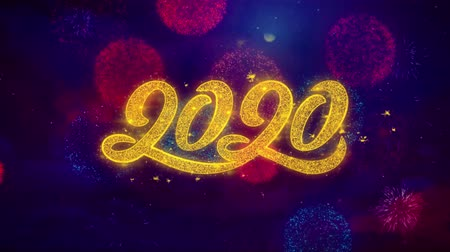 yeni : 2020 New Year Greeting Text with Particles and Sparks Colored Bokeh Fireworks Display 4K. for Greeting card, Celebration, Party Invitation, calendar, Gift, Events, Message, Holiday, Wishes. Stok Video