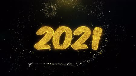 escrita : 2021 Happy new year Written Gold Glitter Particles Spark Exploding Fireworks Display 4K . Greeting card, Celebration, Party Invitation, calendar, Gift, Events, Message, Holiday, Wishes Festival