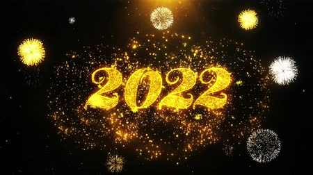 cny : 2022 Happy new year Text Sparks Particles Reveal from Golden Firework Display explosion 4K. Greeting card, Celebration, Party Invitation, calendar, Gift, Events, Message, Holiday, Wishes Festival