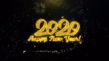 end of year : Happy New Year 2020 Written Gold Glitter Particles Spark Exploding Fireworks Display 4K . Greeting card, Celebration, Party Invitation, calendar, Gift, Events, Message, Holiday, Wishes Festival Stock Footage