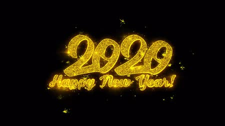 ano novo chinês : Happy New Year 2020 Typography Written with Golden Particles Sparks Fireworks Display 4K. Greeting card, Celebration, Party Invitation, calendar, Gift, Events, Message, Holiday, Wishes Festival