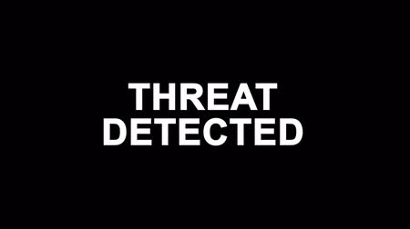detection : Threat Detected Glitch Text Abstract Vintage Twitched 4K Loop Motion Animation . Black Old Retro Digital TV Glitch Effect Including Twitch, Noise, VHS, Distortion. Stock Footage