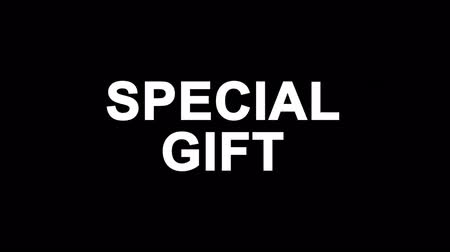 kerstpakket : Special Gift Glitch Text Abstract Vintage Twitched 4K Loop Motion Animatie. Zwart oud Retro Digitaal tv-glitcheffect inclusief twitch, ruis, VHS, vervorming. Stockvideo