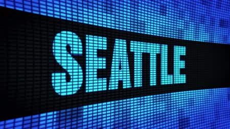 арена : SEATTLE Side Text Scrolling on Light Blue Digital LED Display Board Pixel Light Screen Looped Animation 4K Background. Sign Board , Blinking Light, Pixel Monitor . LED Wall Pannel Стоковые видеозаписи