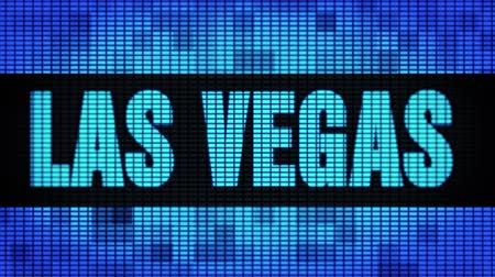 as : LAS VEGAS Front Text Scrolling on Light Blue Digital LED Display Board Pixel Light Screen Looped Animation 4K Background. Sign Board , Blinking Light, Pixel Monitor . LED Wall Pannel Wideo