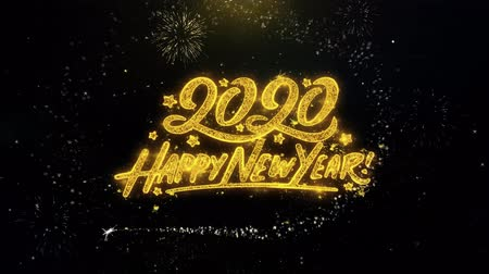 yeni : Happy New Year 2020 Written Gold Glitter Particles Spark Exploding Fireworks Display 4K . Greeting card, Celebration, Party Invitation, calendar, Gift, Events, Message, Holiday, Wishes Festival Stok Video