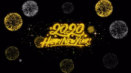 yeni : Happy New Year 2020 Golden Greeting Text Appearance Blinking Particles with Golden Fireworks Display 4K for Greeting card, Celebration, Invitation, calendar, Gift, Events, Message, Holiday, Wishes . Stok Video