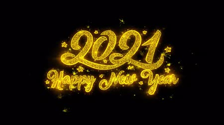 írott : New Year 2021 Typography Written with Golden Particles Sparks Fireworks Display 4K. Greeting card, Celebration, Party Invitation, calendar, Gift, Events, Message, Holiday, Wishes Festival Stock mozgókép