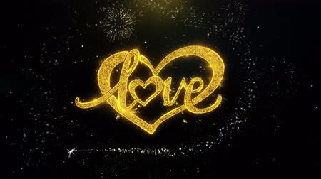escrita : love valentines day heart Written Gold Glitter Particles Spark Exploding Fireworks Display 4K . Greeting card, Celebration, Party Invitation, calendar, Gift, Events, Message, Holiday.