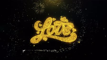 írott : Valentines Love Written Gold Glitter Particles Spark Exploding Fireworks Display 4K . Greeting card, Celebration, Party Invitation, calendar, Gift, Events, Message, Holiday, Wishes Festival