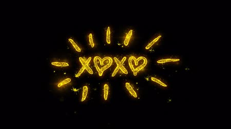 oklar : XOXO Valentines Day Typography Written with Golden Particles Sparks Fireworks Display 4K. Greeting card, Celebration, Party Invitation, calendar, Gift, Events, Message, Holiday, Wishes Festival