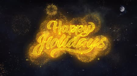 feliz : Happy Holidays Text Typography Reveal From Golden Firework Crackers Particles Night Sky 4k Background. Greeting card, Celebration, Party, Invitation, Gift, Event, Message, Holiday, Wish, Festival Stock Footage