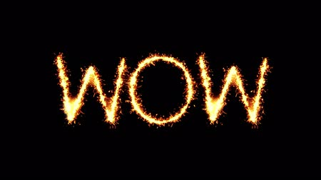 popart : Wow Text Sparkler Writing With Glitter Sparks Particles Firework on Black 4K Loop Background. Greeting card, Invitation, Celebration, Party, Gift, Message, Wishes, Festival.