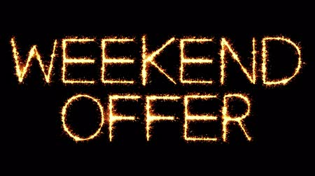 cupom : Weekend Offer Text Sparkler Writing With Glitter Sparks Particles Firework on Black 4K Loop Background. Greeting card, Invitation, Celebration, Party, Gift, Message, Wishes, Festival. Vídeos