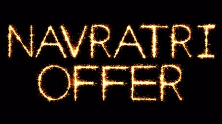 puja : Navratri Offer Text Sparkler Writing With Glitter Sparks Particles Firework on Black 4K Loop Background. Greeting card, Invitation, Celebration, Party, Gift, Message, Wishes, Festival.