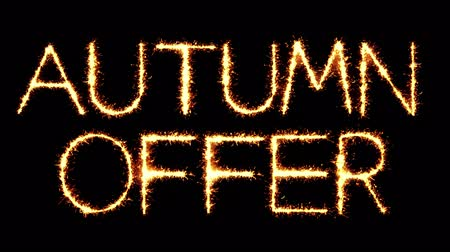 autumnal : Autumn Offer Text Sparkler Writing With Glitter Sparks Particles Firework on Black 4K Loop Background. Greeting card, Invitation, Celebration, Party, Gift, Message, Wishes, Festival.