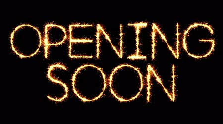 soon : Opening Soon Text Sparkler Writing With Glitter Sparks Particles Firework on Black 4K Loop Background. Greeting card, Invitation, Celebration, Party, Gift, Message, Wishes, Festival.
