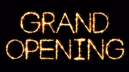 soon : Grand Opening Text Sparkler Writing With Glitter Sparks Particles Firework on Black 4K Loop Background. Greeting card, Invitation, Celebration, Party, Gift, Message, Wishes, Festival. Stock Footage