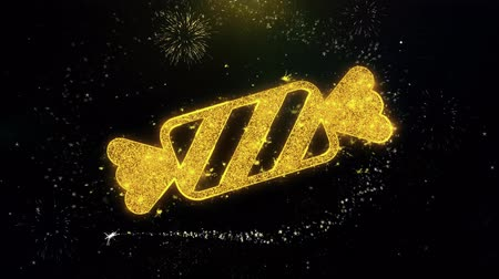 pepermunt : Candy Icon on Gold Glitter Particles Spark Exploding Fireworks Display . Object, Shape, Text, Design, Element, Symbol 4K Animation. Stockvideo