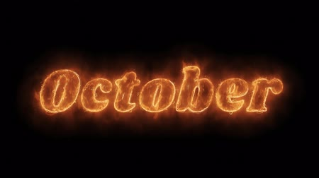 anual : October Word Hot Animated Burning Realistic Fire Flame and Smoke Seamlessly loop Animation on Isolated Black Background. Fire Word, Fire Text, Flame word, Flame Text, Burning Word, Burning Text.