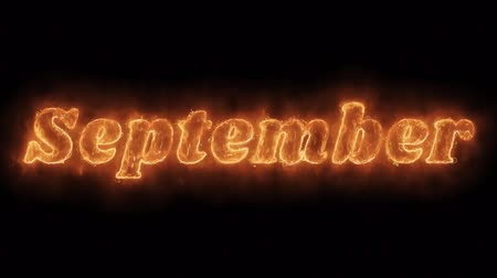 anual : September Word Hot Animated Burning Realistic Fire Flame and Smoke Seamlessly loop Animation on Isolated Black Background. Fire Word, Fire Text, Flame word, Flame Text, Burning Word, Burning Text.