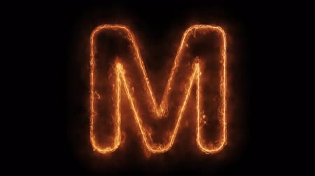 strojopis : Alphabet M Word Hot Animated Burning Realistic Fire Flame and Smoke Seamlessly loop Animation on Isolated Black Background. Fire Word, Fire Text, Flame word, Flame Text, Burning Word, Burning Text. Dostupné videozáznamy