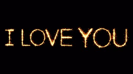 verdadeiro : I Love You Text Sparkler Writing With Glitter Sparks Particles Firework on Black 4K Loop Background. Greeting card, Invitation, Celebration, Party, Gift, Message, Wishes, Festival.