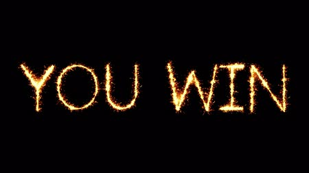 végső : You Win Text Sparkler Writing With Glitter Sparks Particles Firework on Black 4K Loop Background. Greeting card, Invitation, Celebration, Party, Gift, Message, Wishes, Festival. Stock mozgókép