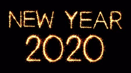 yeni : New Year 2020 Text Sparkler Writing With Glitter Sparks Particles Firework on Black 4K Loop Background. Greeting card, Invitation, Celebration, Party, Gift, Message, Wishes, Festival.