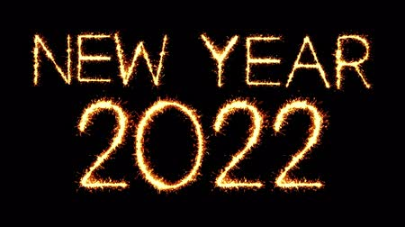 end of year : New Year 2022 Text Sparkler Writing With Glitter Sparks Particles Firework on Black 4K Loop Background. Greeting card, Invitation, Celebration, Party, Gift, Message, Wishes, Festival.