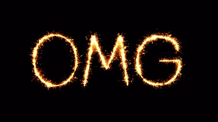 comics pop : Omg Text Sparkler Writing With Glitter Sparks Particles Firework on Black 4K Loop Background. Greeting card, Invitation, Celebration, Party, Gift, Message, Wishes, Festival.