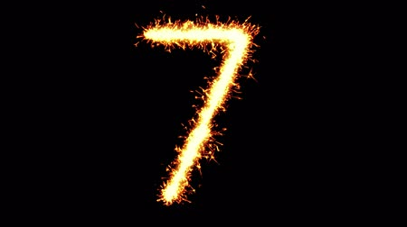 sete : Number 7 Text Sparkler Writing With Glitter Sparks Particles Firework on Black 4K Loop Background. letter , alphabet , typography , Typeface , Font , character . Stock Footage