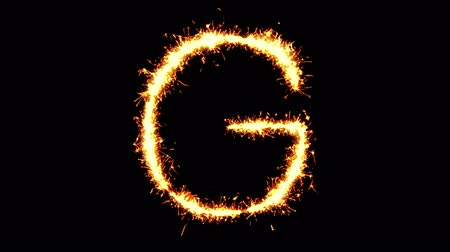 vonk : Alphabet G Text Sparkler Writing With Glitter Sparks Particles Firework on Black 4K Loop Background. letter , alphabet , typography , Typeface , Font , character .