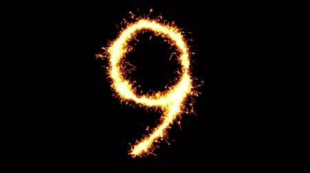asal : Number 9 Text Sparkler Writing With Glitter Sparks Particles Firework on Black 4K Loop Background. letter , alphabet , typography , Typeface , Font , character .