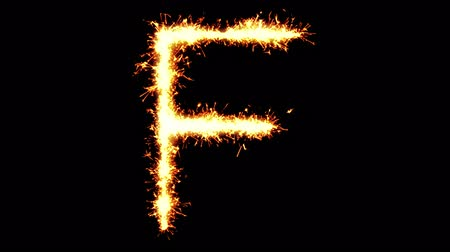 letter f : Alphabet F Text Sparkler Writing With Glitter Sparks Particles Firework on Black 4K Loop Background. letter , alphabet , typography , Typeface , Font , character . Stock Footage